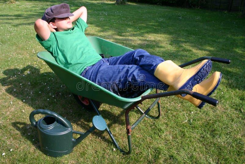 Young gardener having a break royalty free stock images