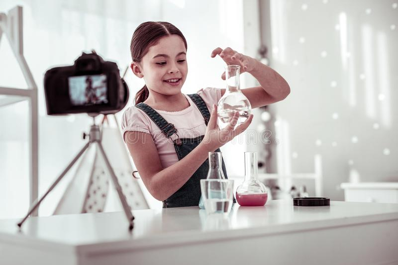 Cute smart girl being interested in science royalty free stock photo