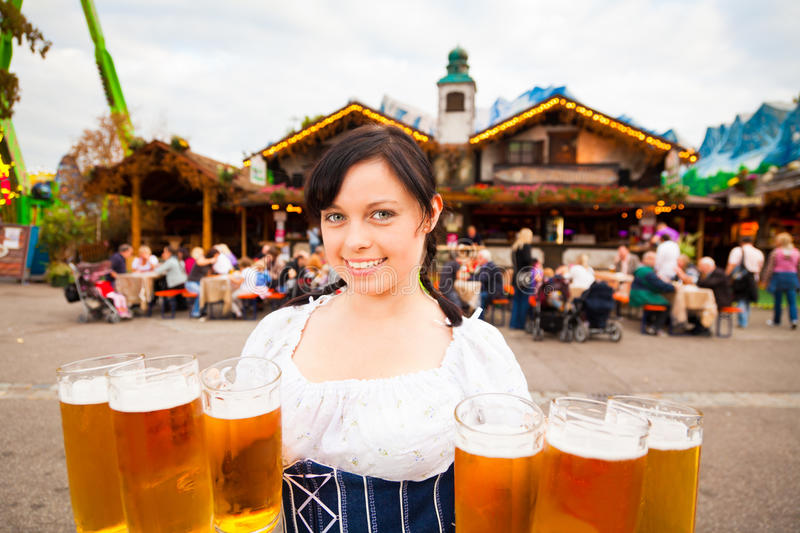 Young German Woman Serving Beer. At festival royalty free stock images