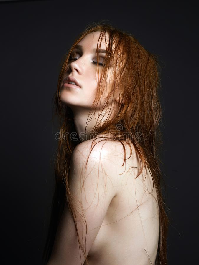 Young ginger woman. Naked Beautiful Girl with wet hair royalty free stock photography