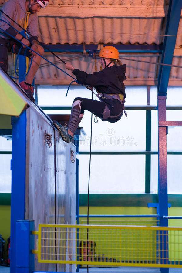 Young girl Abseiling royalty free stock image