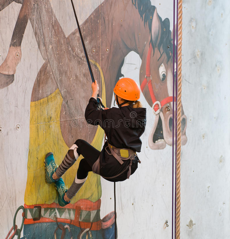 Young girl Abseiling stock image
