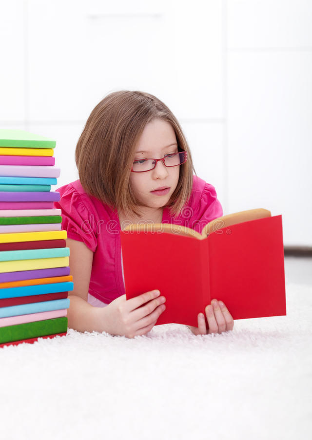 Young Girl Absorbed By Reading Stock Photo