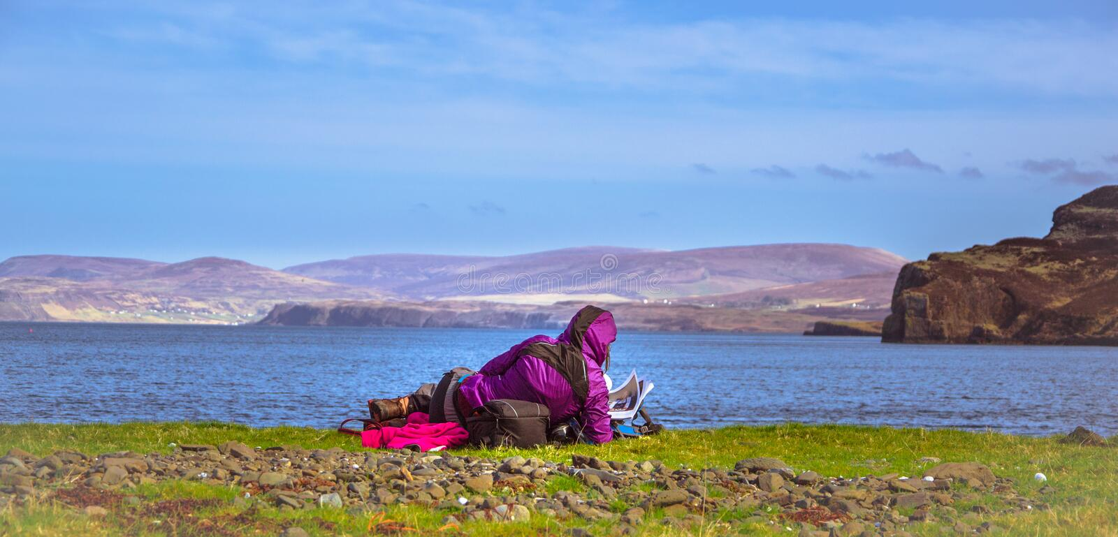 Young girl admiring ocean and mountains - Isle of Skye, Scotland royalty free stock photography