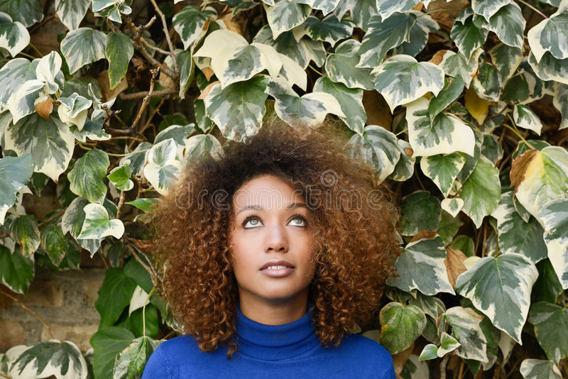 Young girl with afro hairstyle in urban background royalty free stock photos