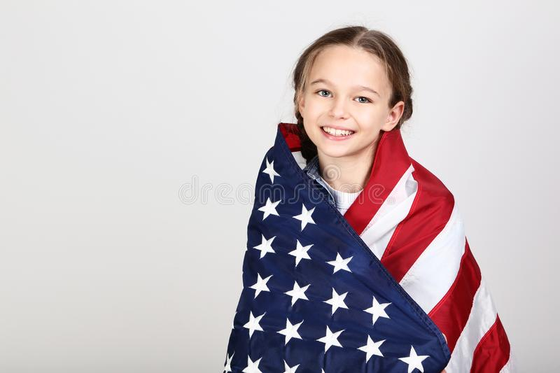 Girl with American flag royalty free stock photography