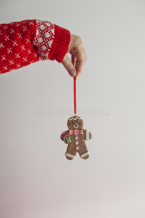 Young girl arm holding a gingerbread doll stock photography