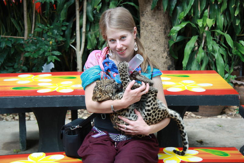 Young girl with a baby leopard royalty free stock photo