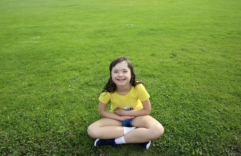 Young girl on the background of green grass stock photos
