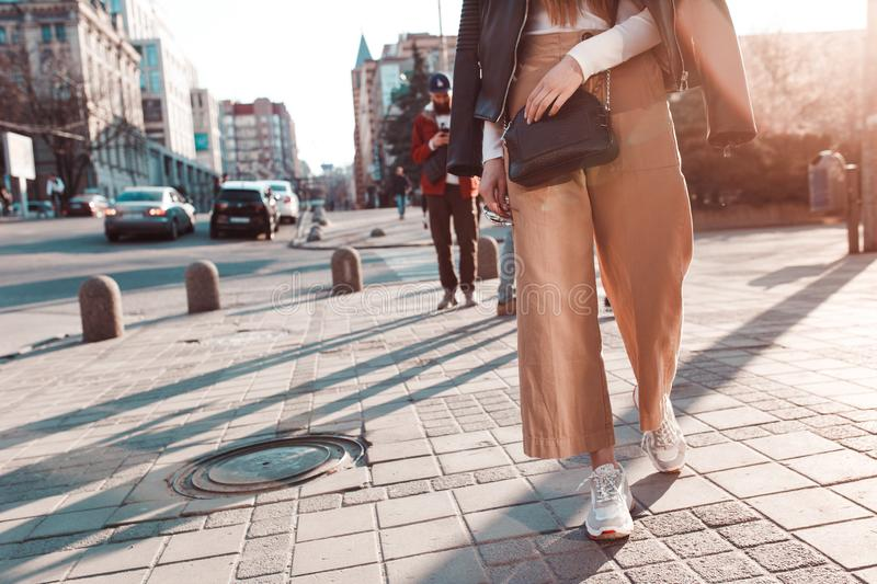 Young girl on the background of the setting sun, walking through the city royalty free stock image