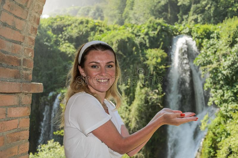 Young girl on the background of a waterfall Cascata delle Marmore in Italy stock images
