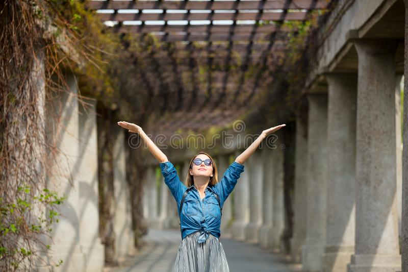 Girl Walking On Alley With Arches And Columns Stock Photo ...