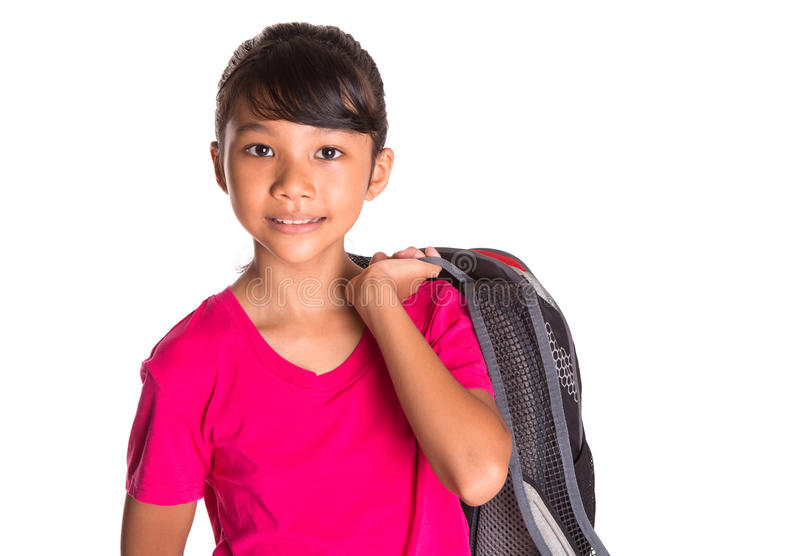 Young Girl With Backpack XIII. A young Asian Malay girl student with a backpack stock photo