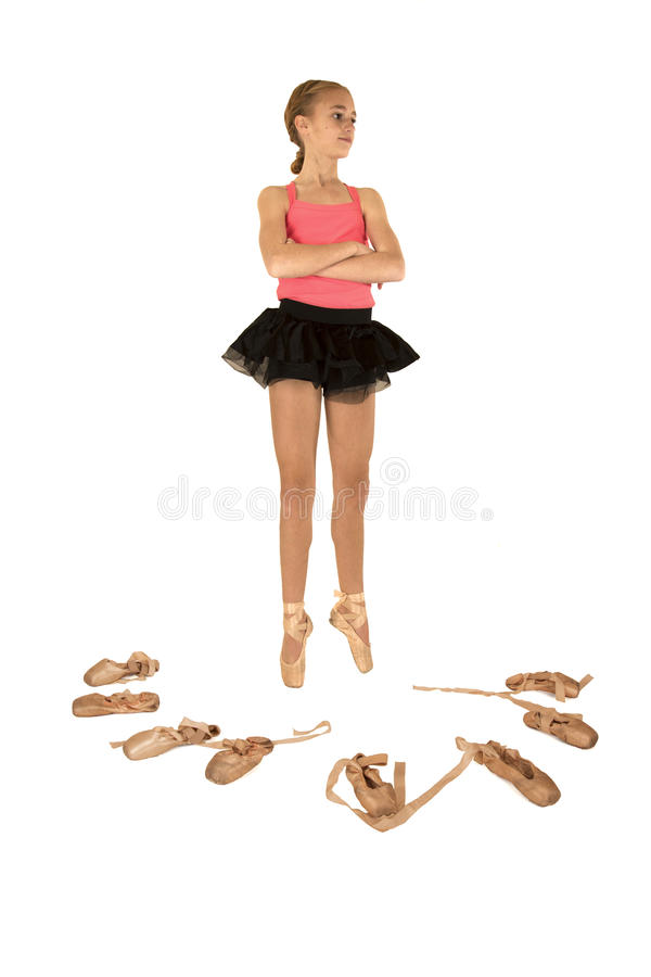 Young girl ballerina surrounded by ballet shoes ar royalty free stock photo