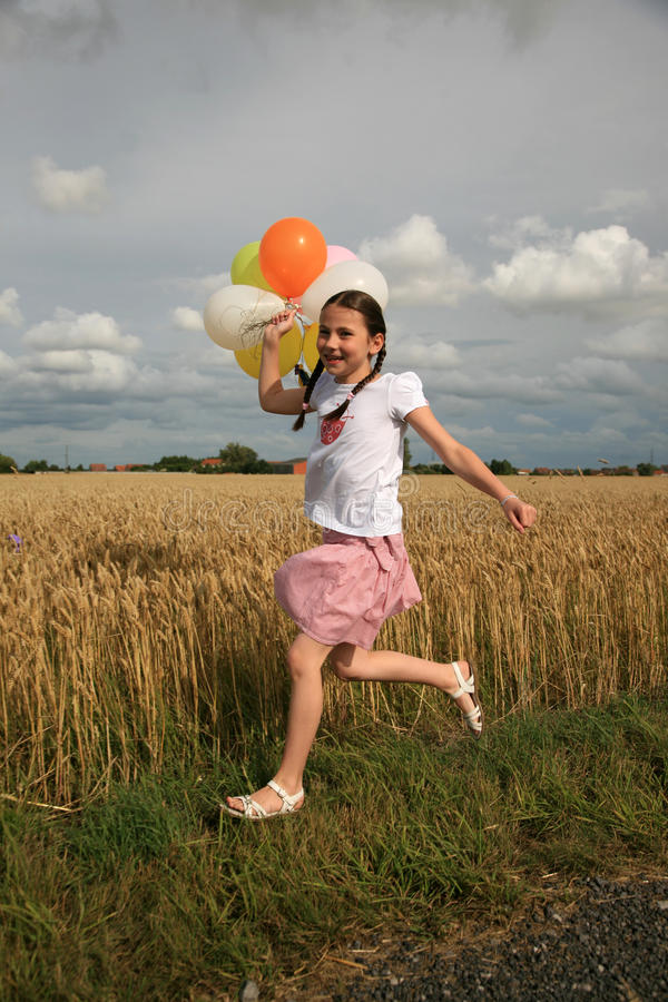 Young girl with balloon stock photography