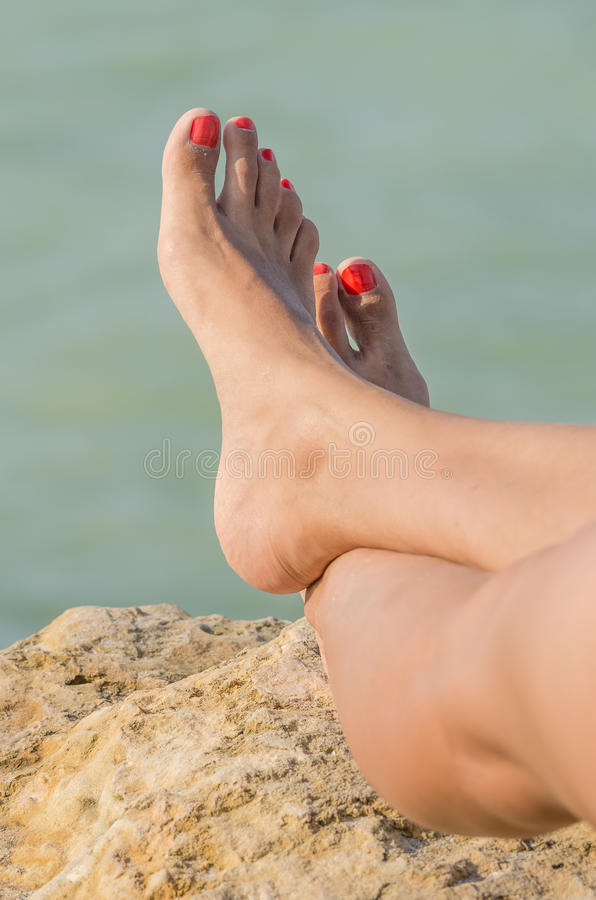 Young Girl Bare Feet Tanning On The Beach royalty free stock photo