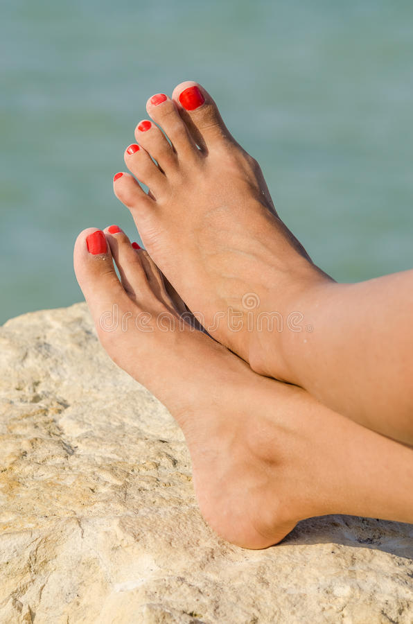 Young Girl Bare Feet Tanning On The Beach stock photography