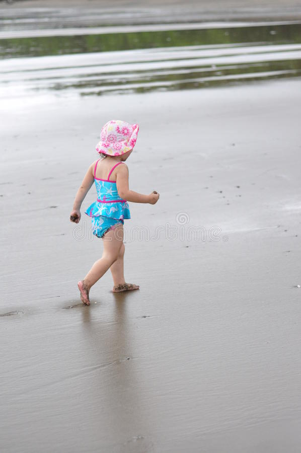 Young girl on beach royalty free stock photos