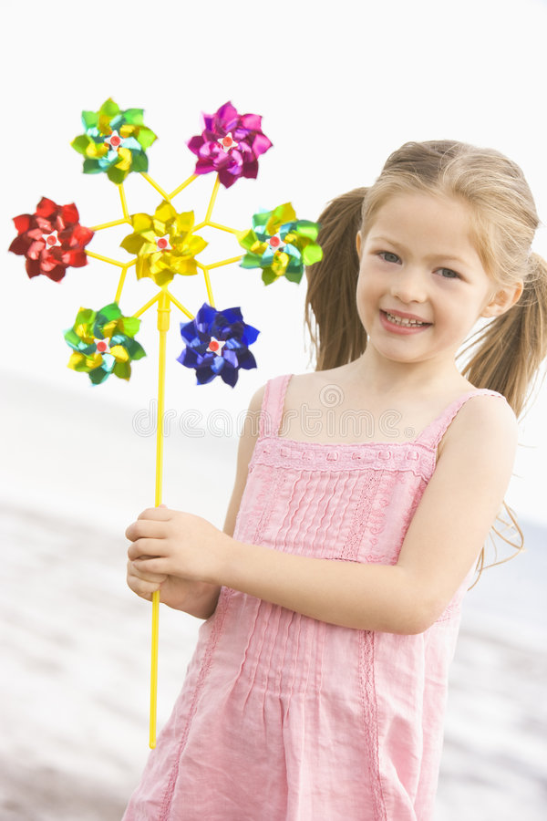 Download Young Girl At Beach With Toy Windmill Smiling Stock Image - Image: 5944523