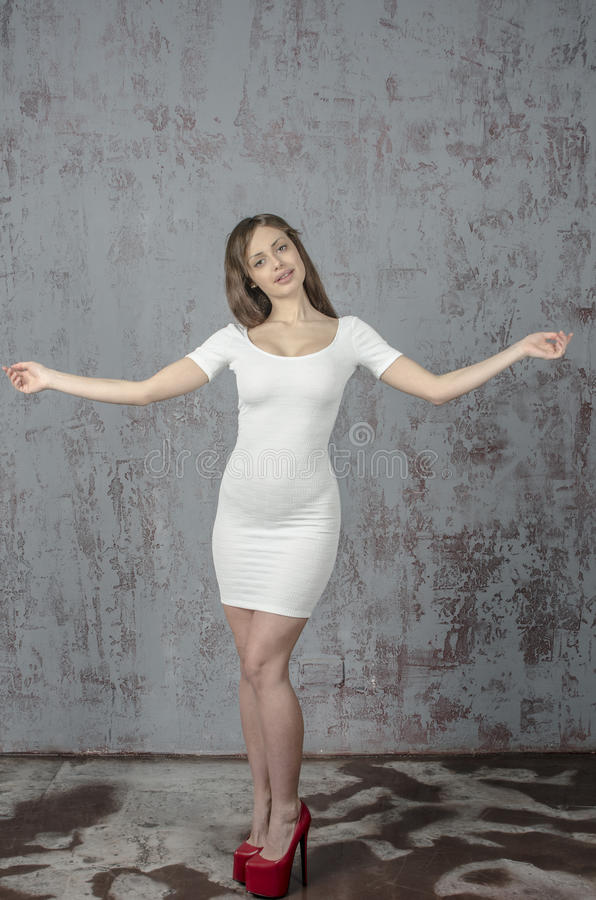 Young Girl With A Beautiful Figure In Trendy White Dress