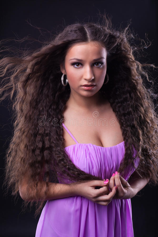 Young girl with beauty long hair look at you stock photos