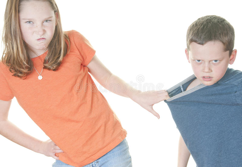Young girl being mean to boy royalty free stock images