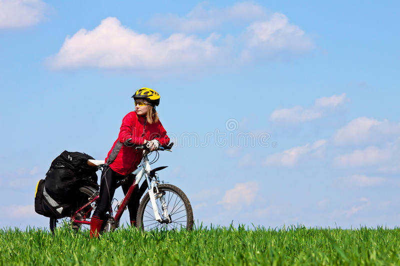 Young girl with bicycle stock photography