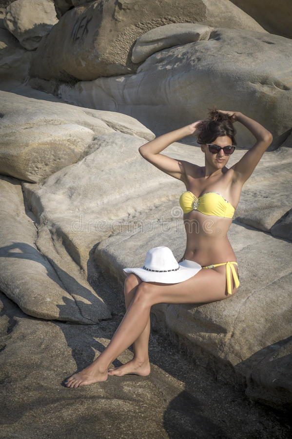 Young girl in bikini leaning royalty free stock images