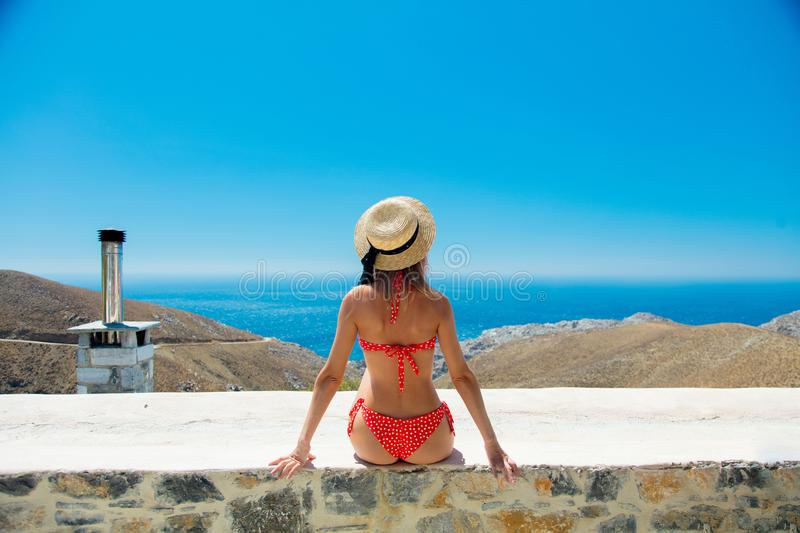 Girl in bikini with blue sea and sky on background royalty free stock image