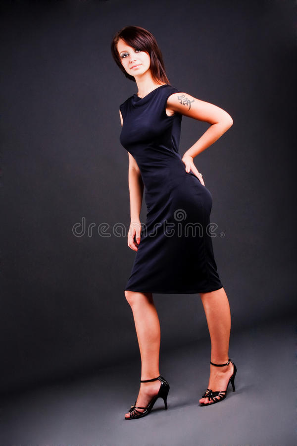 Young girl in black dress stock photo