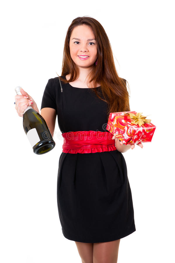 Download Young Girl In Black Dress Holding A Gift Stock Photos - Image: 22416273