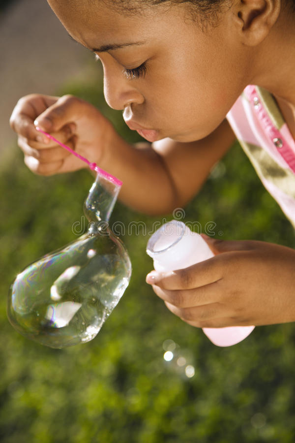 Free Young Girl Blowing Bubbles Royalty Free Stock Photography - 12529007