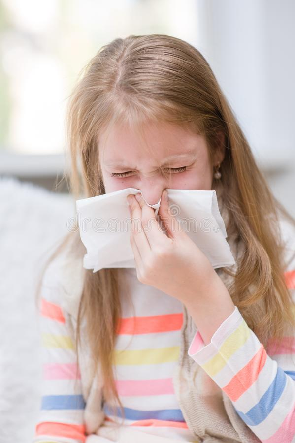 Young girl blowing her nose stock photo