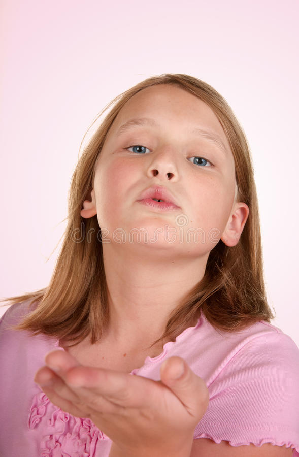 Download Young girl blowing a kiss stock photo. Image of blowing - 13032992