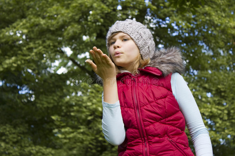 Young girl blowing wind with lips royalty free stock photography