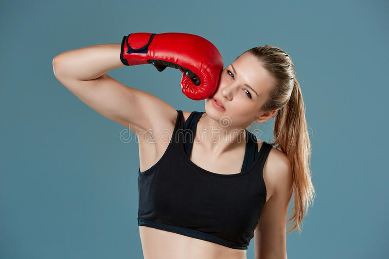 Young girl boxer punching herself as self stock photo