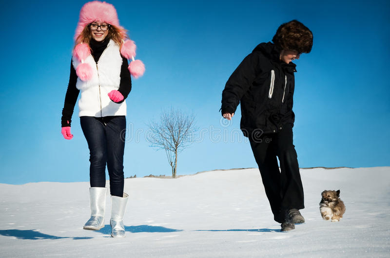 Young girl and boy playing in winter royalty free stock photos