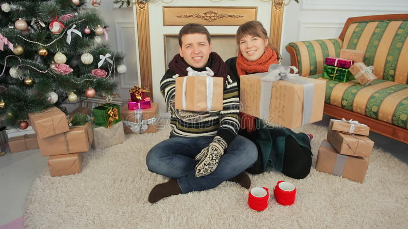 A Young Girl And A Boyfriend Exchange Christmas Gifts. Christmas And ...