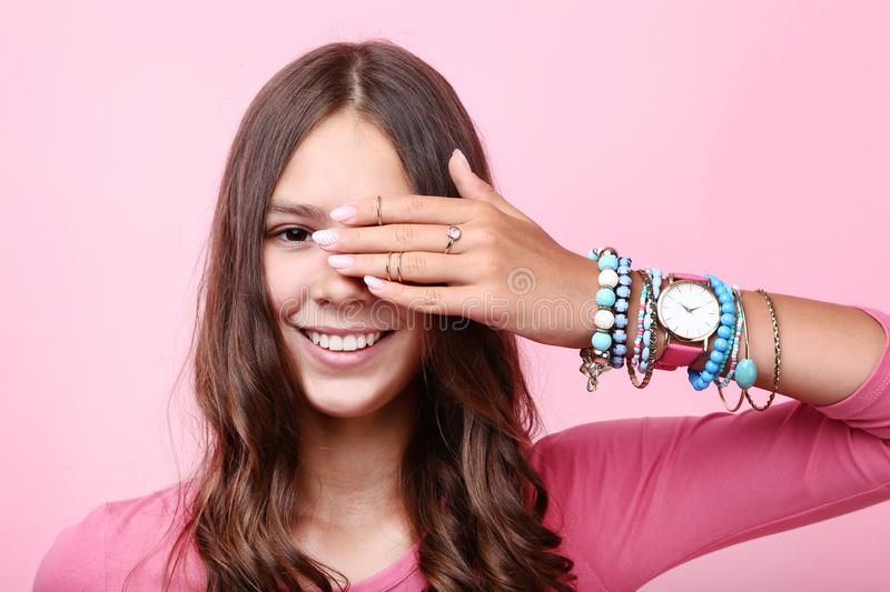 Girl with bracelets and rings stock photo