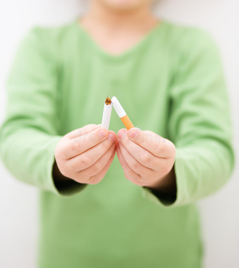 Young girl is breaking a cigarette. Quit smoking concept royalty free stock photos