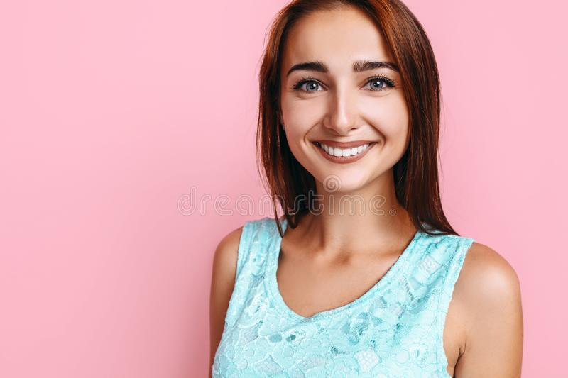Young girl, in a bright dress, smiling and posing on a pink background. Beautiful young girl, in a bright dress, smiling and posing on a pink background stock photos