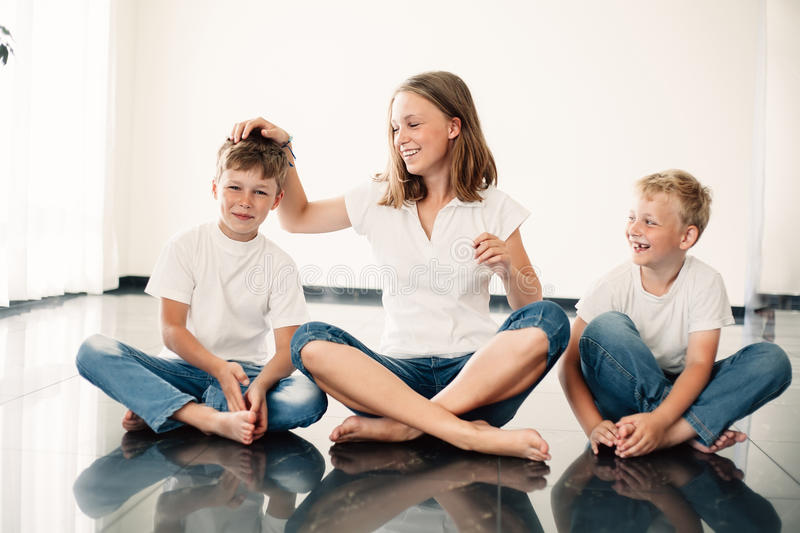 Young girl with brothers stock photography
