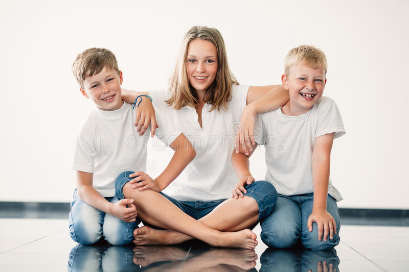 Young girl with brothers stock image