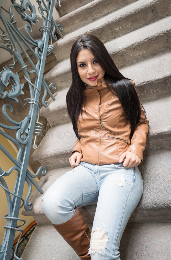 Young girl in brown leather boots and jacket stock image