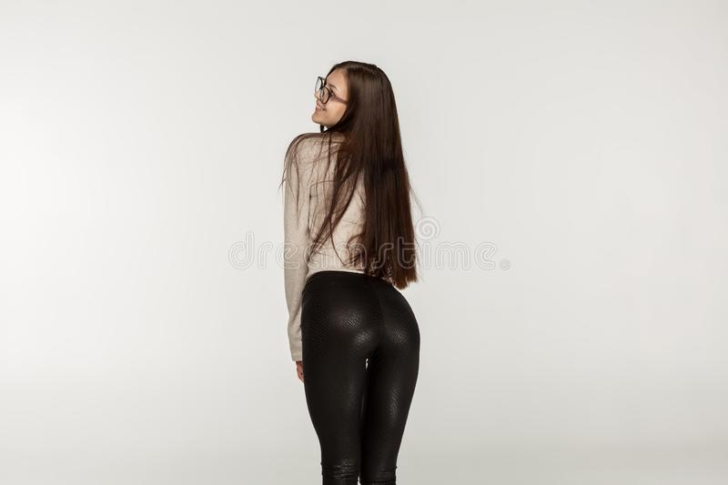 Young girl with brunette hair in black leggings royalty free stock photography