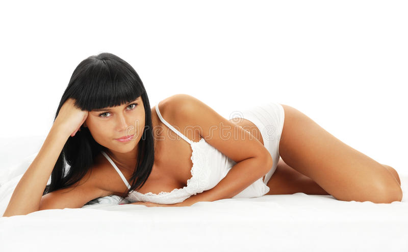 Download Young Girl - Brunette On White Bed Stock Photo - Image: 14862432