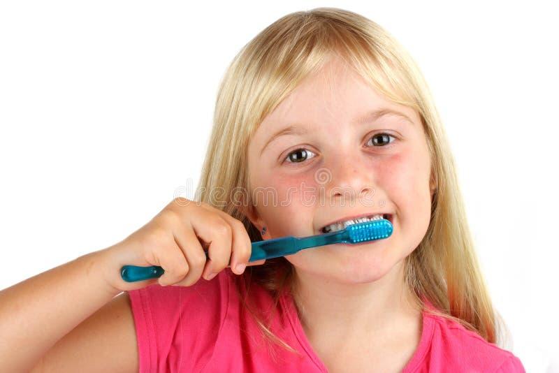 Young girl brushing her teeth stock photo