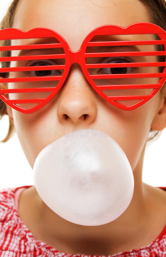 Young girl with bubble gum baloon stock image