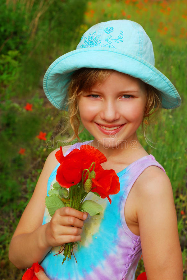 Download Young Girl  With Bunch Of  Poppy Stock Image - Image: 15002441