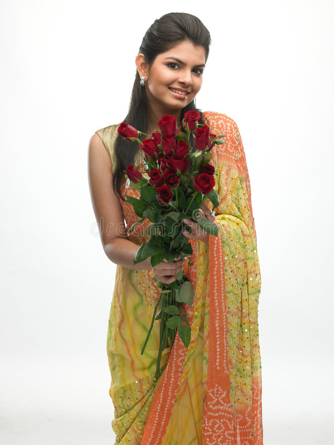 Young girl with bunch of red-roses royalty free stock images